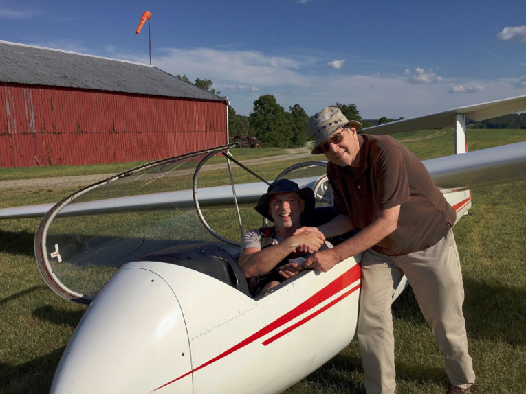 Luke Landau joined PSA, along with his dad, Tom, in April. Luke holds an ATP rating and arrived with experience in many types of aircraft. He is rapidly progressing toward adding a glider rating – and endorsements to join our tow pilot corps. – to his aeronautical achievements. His first glider solo was on June 19, 2016. He is shown being congratulated by Al Bennett CFIG in the photo.