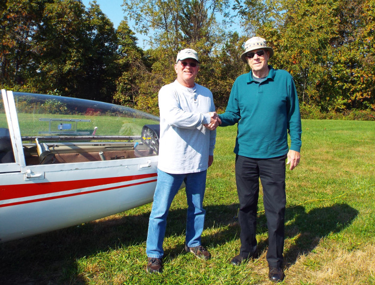 """Pittsburgh, PA, October 15, 2016: As our soaring season draws to a close, we celebrate the solo flight of another new member, Bill Heilmann. """"Capt. Bill"""" joined us in late April with extensive flying experience – he's flown most everything from cubs to the """"big iron"""" that he flies on international routes for a major airline. Bill is a welcome addition to our Roster. He is shown being congratulated by Al Bennett CFIG following an excellent (of course!) flight in our L23 Super Blanik."""